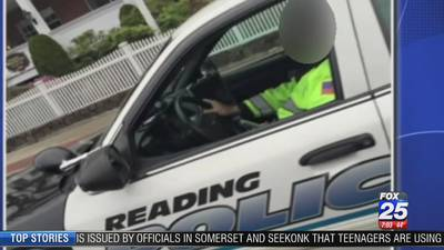 Police investigating photo that appears to show officer texting while driving