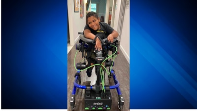 Boy with cerebral palsy walks for first time with robotic walker
