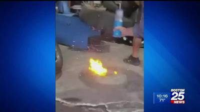Caught on camera: Racing wheel explodes inside Lawrence tire shop